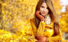 bigstock-young-woman-with-autumn-leaves-49076390