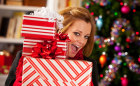 woman-with-stack-of-christmas-presents