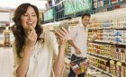 Woman checking out man in grocery store